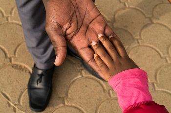 """Karen, age 3, holds hands with her father Iddi Badi, age 34, outside of the school building at the Little Rock Early Childhood Development Centre in Kibera, Nairobi, Kenya, May 16, 2017.    """"This is Karen's second year. I love this school, the way they nurture and bring the children up, and the way that she learns to interact and express herself. They don't discriminate against any children here."""" said Iddi Badi.  The first five years of life have a profound effect on a child's future – on her health, education, wellbeing and financial success as an adult.  When parented with love, nourished and cared for in safe and stimulating environments, children develop the cognitive, emotional and behavioural skills they need to embrace opportunity and bounce back from adversity. They start life with a fair chance to grow, thrive and contribute to their communities and the world.   But far too many children are denied the right to adequate nutrition, protection and the stimulation that comes from talk, play and responsive attention from caregivers.  These deprivations not only hold back individual children, they launch a cycle of disadvantage and inequity that can continue for generations.   Recent advances in neuroscience pinpoint the environmental factors that can disrupt development. This neuroscience points to exciting new ways to protect vulnerable children and help them build resilience so they can survive, grow and reach their full potential. Early in life, a child develops cognitive, language and psychosocial skills, a process known as early childhood development (ECD).  Recent discoveries in neuroscience have provided a growing list of details about how a baby's brain develops during this time of life. As a result, we know that a baby's brain is constructed by a complex interplay of rapid neural connections that begin before birth. In a child's first years, these connections occur at a once-in-a lifetime speed of 700 to 1,000 a second.  As the brain-build"""